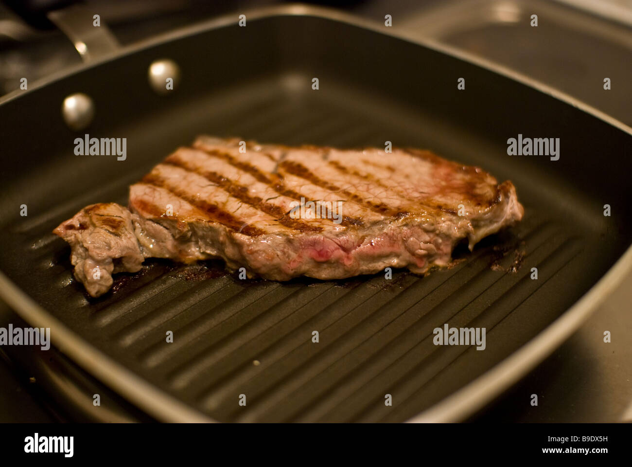 A Sirloin Steak Frying In A Griddle Pan Stock Image Hatch Chiles Roasting  On A Griddle How To Cook Pork Chops On Griddle