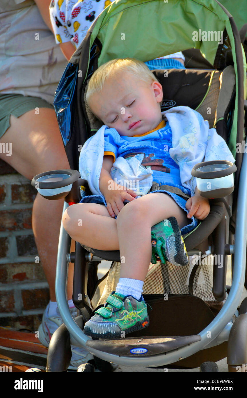 Infant Baby Boy Naps In Stroller At Downtown Disney