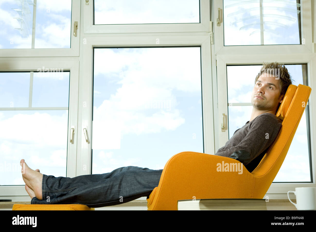 Man Young Chairs Relaxing At The Side People 20 30 Years Living Room Stock Photo 23088136 Alamy