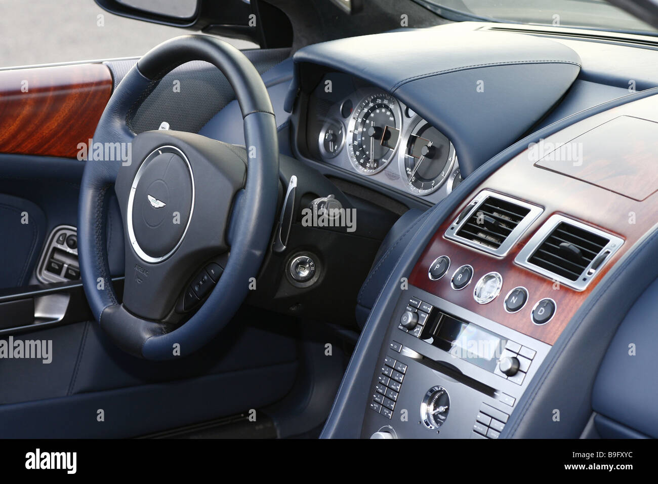 Car Aston Martin DB9 Volante Cockpit Detail Series Car Sport Cars Cabrio  Driver Side Armatures Wood Leather Symbol Spin Driving