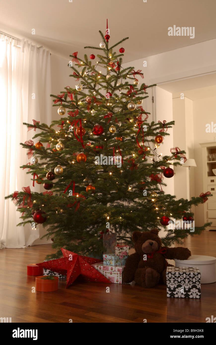 stock photo living room christmas tree gifts teddy bear illumination gift giving custom hood gifts decorated christmas eve wooden floor - Bear Christmas Tree