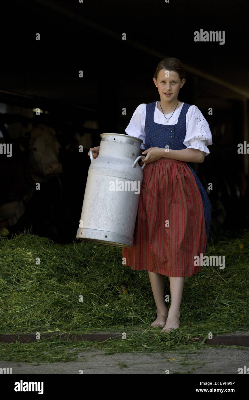 http://c8.alamy.com/comp/B9H99P/girl-farm-barnstable-milk-can-carry-B9H99P.jpg