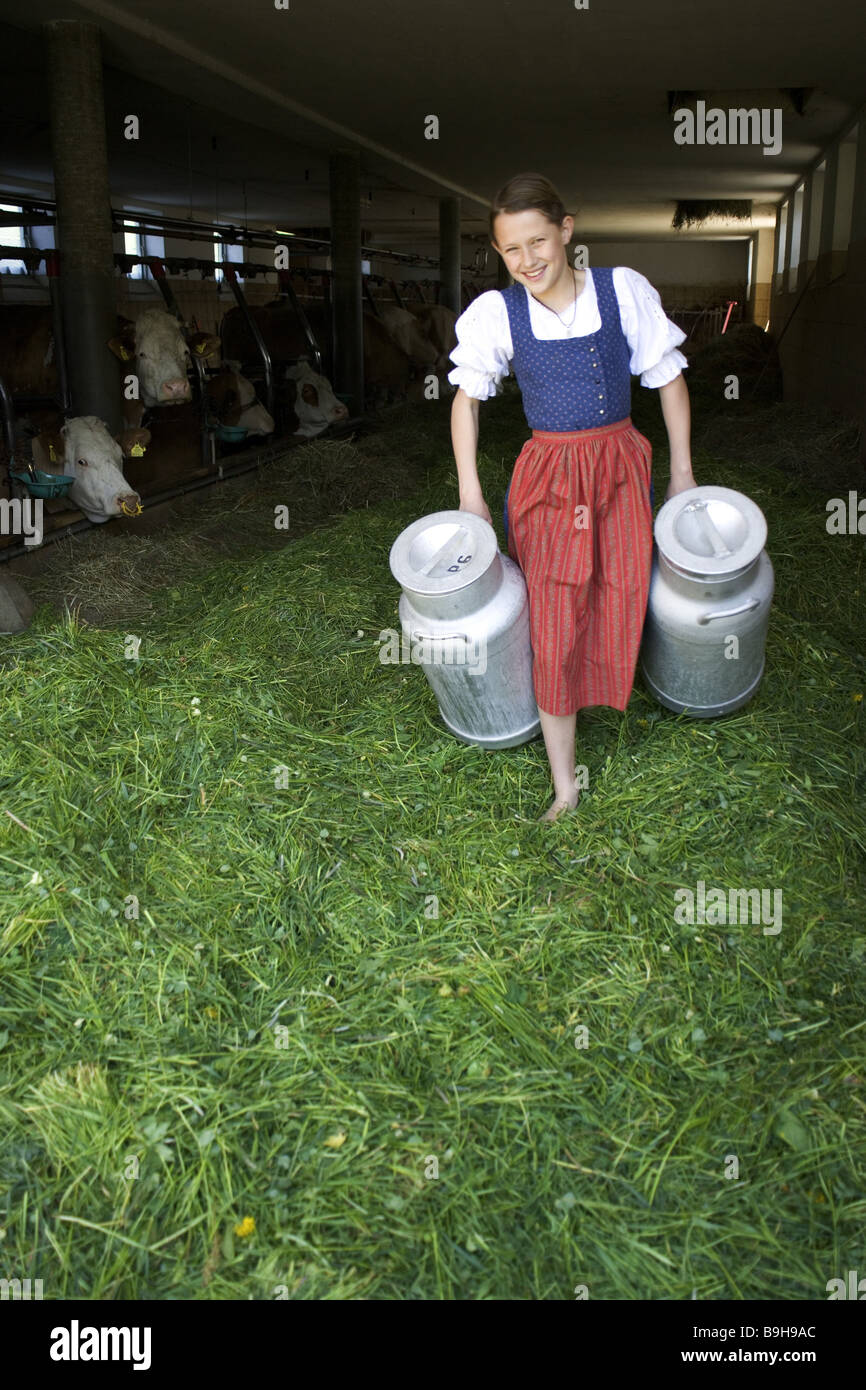 http://c8.alamy.com/comp/B9H9AC/girl-farm-barnstable-milk-cans-carry-13-years-work-task-barefoot-farm-B9H9AC.jpg
