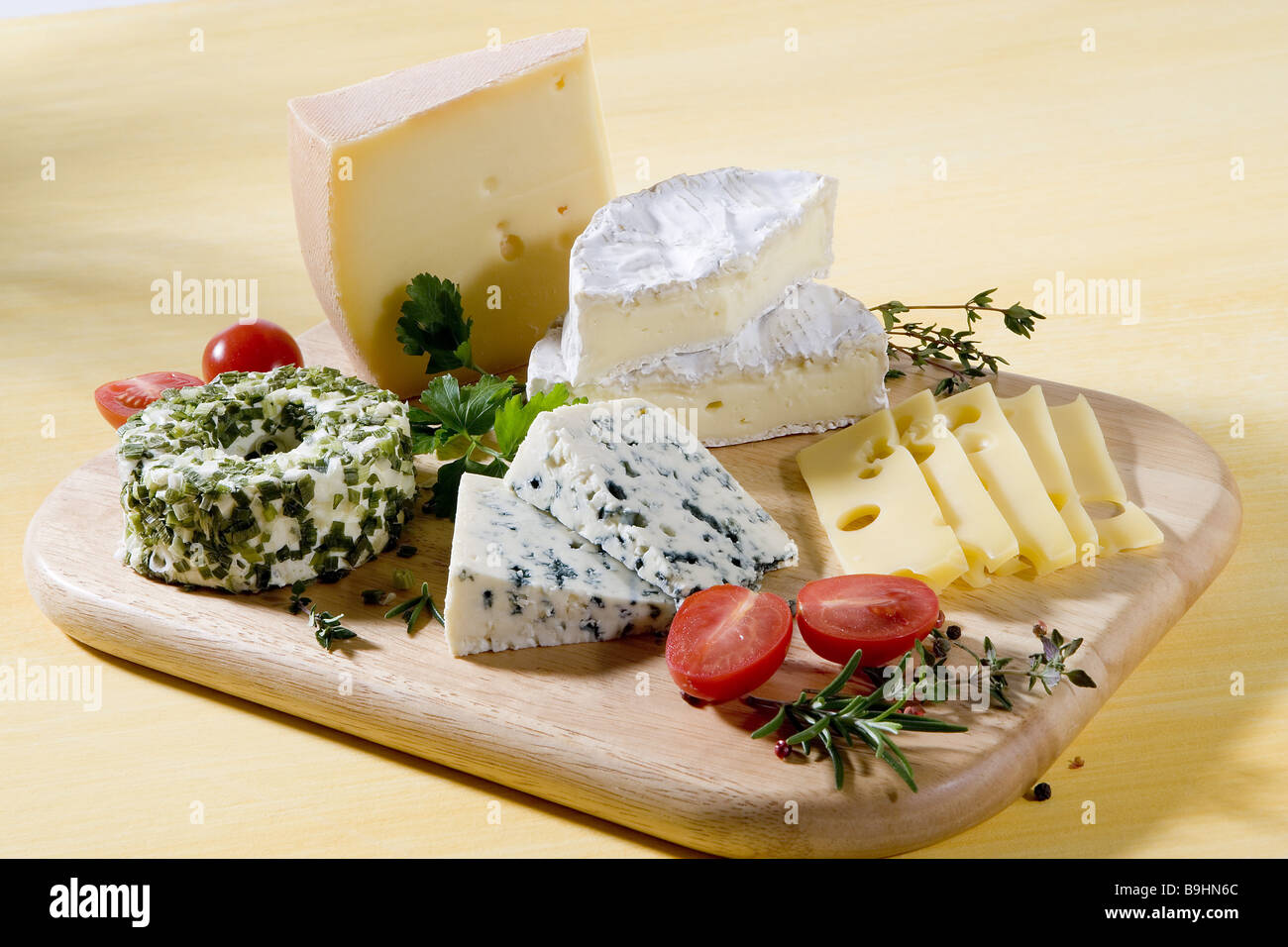 Cheese-plate series food still life cheese-plates cheese selection kinds differently milk-products herbs tomatoes & Cheese-plate series food still life cheese-plates cheese selection ...