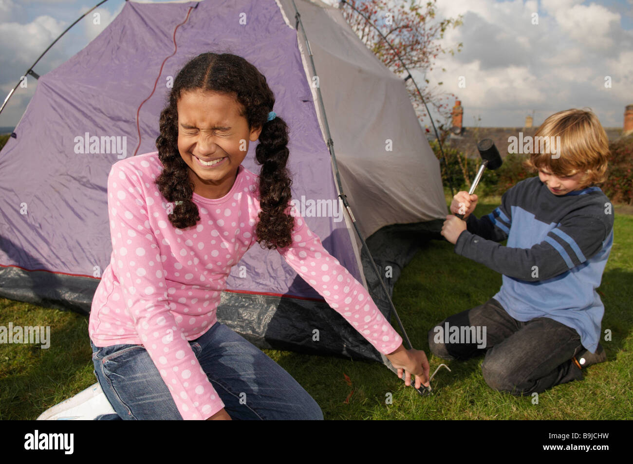 Boy and Girl erecting tent  sc 1 st  Alamy & Boy and Girl erecting tent Stock Photo Royalty Free Image ...