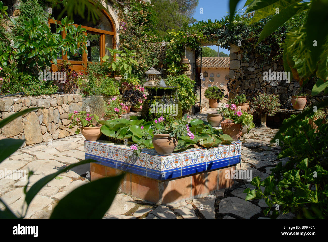 Spanish Courtyard Garden With Formal Pond And Water