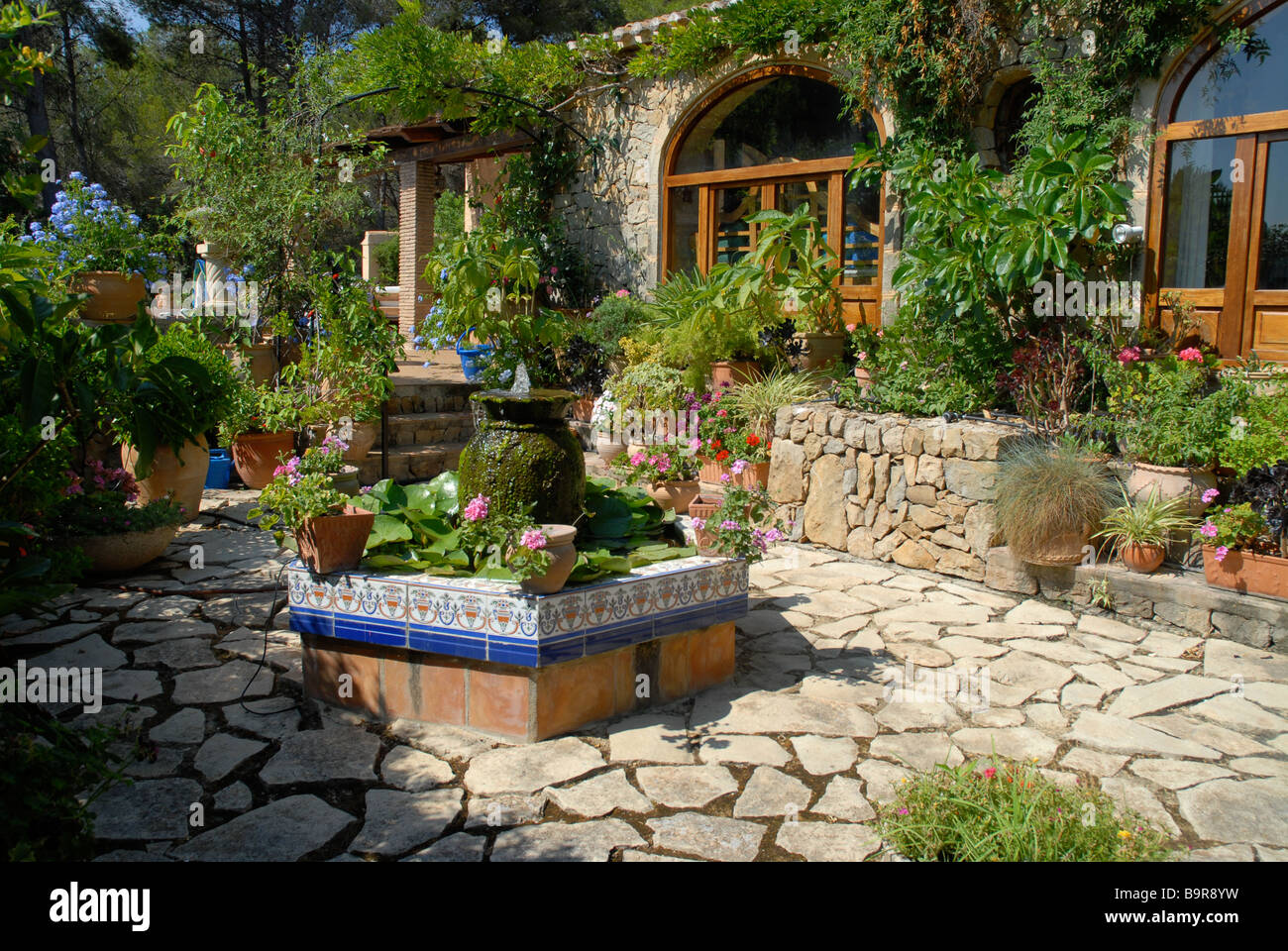 Spanish courtyard garden with formal pond and water for Spanish garden designs