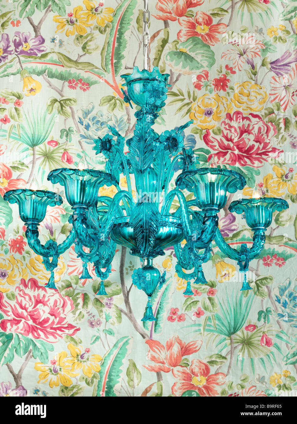 Green crystal chandelier with floral background stock photo green crystal chandelier with floral background aloadofball Image collections
