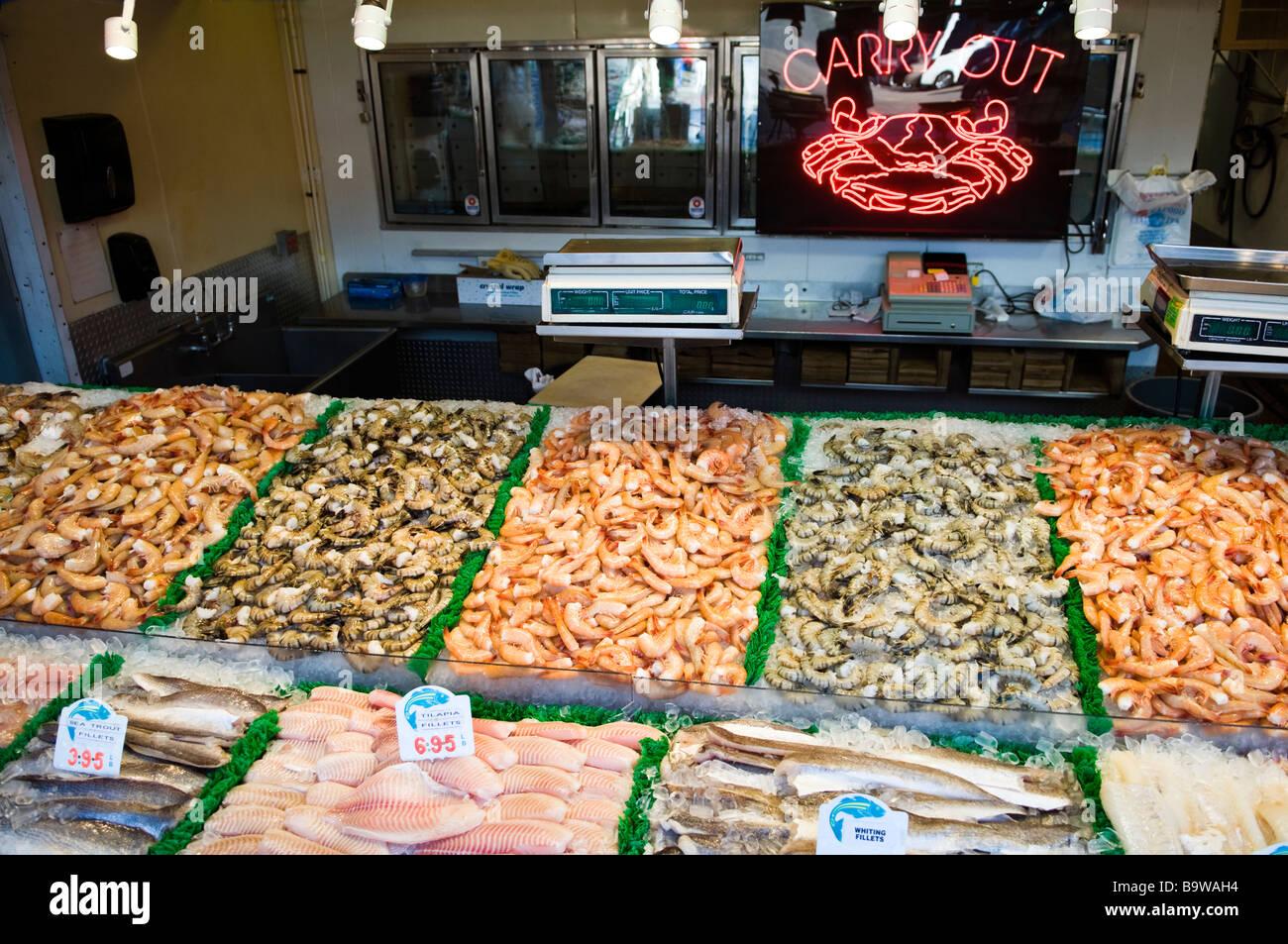 Fresh seafood displayed at the fish market at the wharf in for Washington fish market