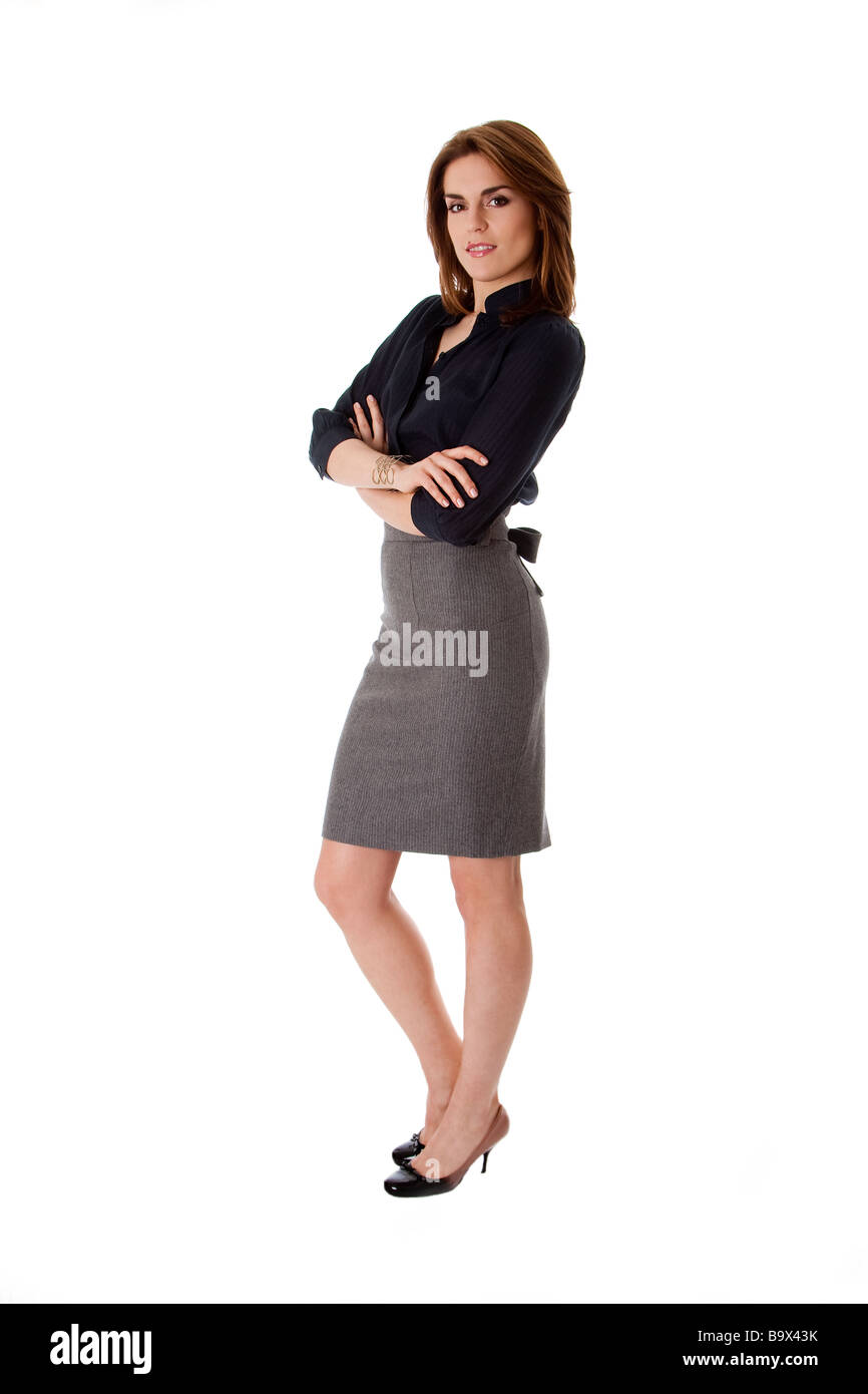 Beautiful brunette business woman standing wearing gray skirt and ...
