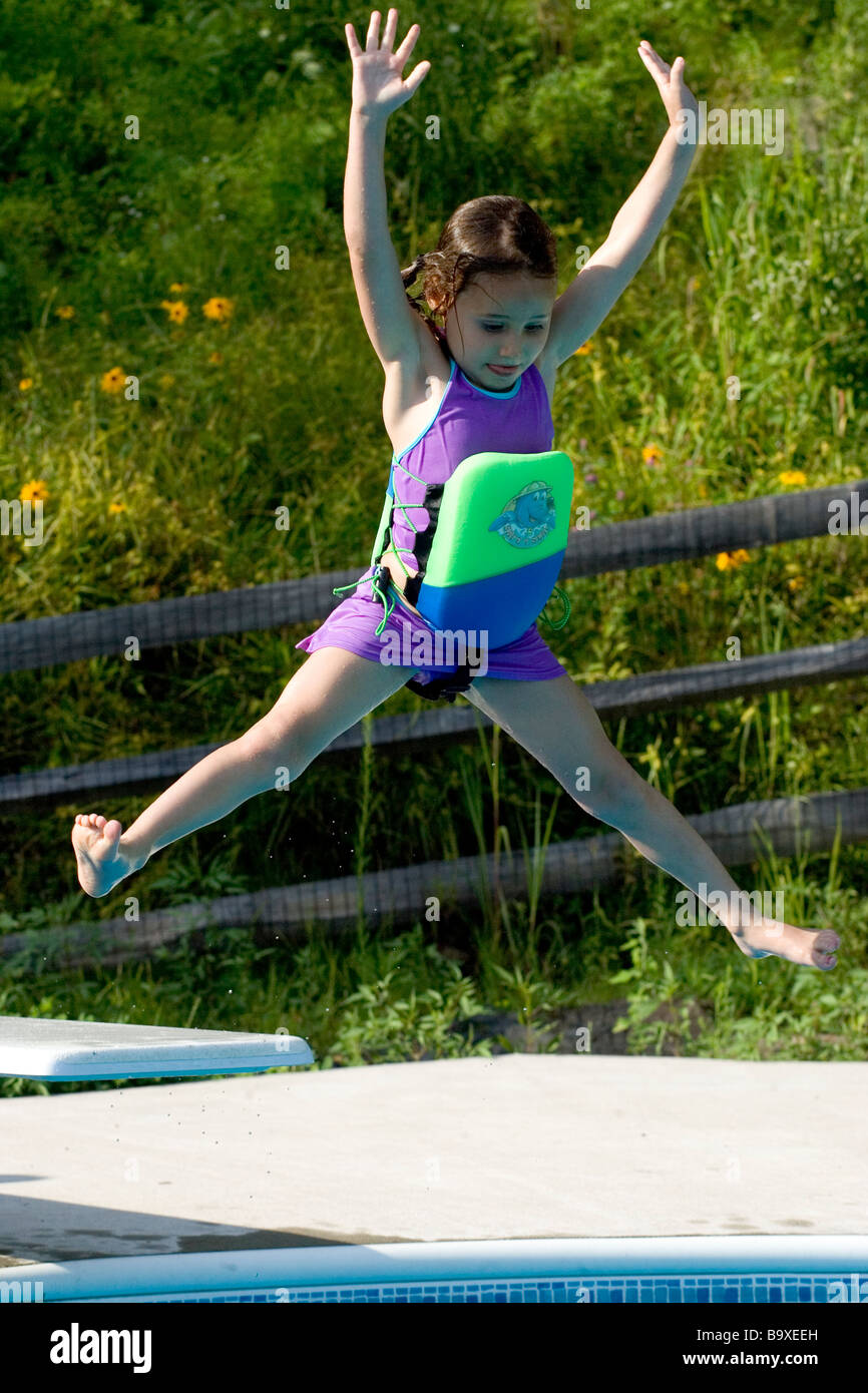 5 Year Old Girl Jumping Off Diving Board Into Swimming