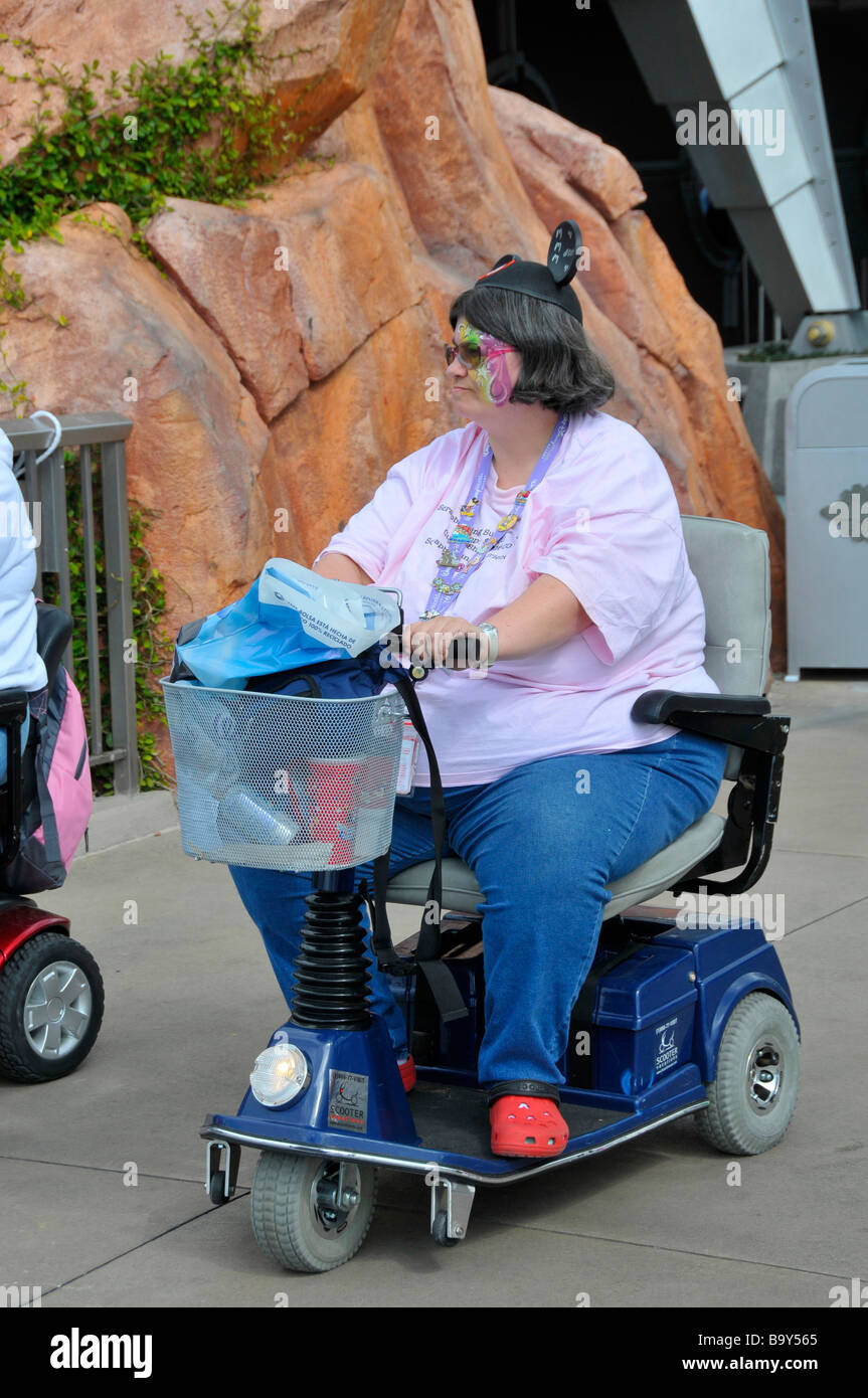 Overweight handicapped white female with mouse ears rides for Motorized scooter disney world