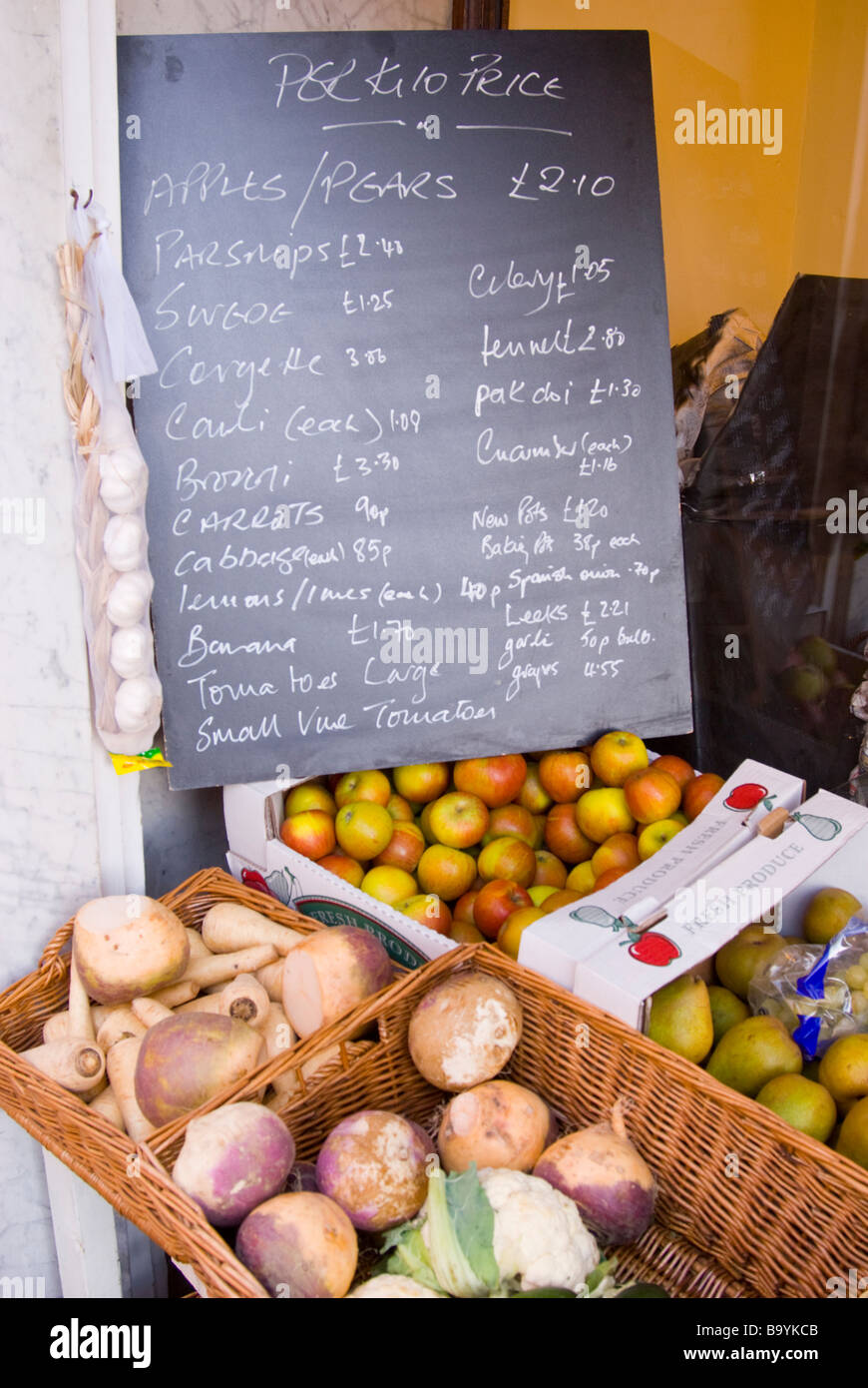 Fruit And Vegetables For Sale Outside A Uk Shop Store With Prices On A  Blackboard