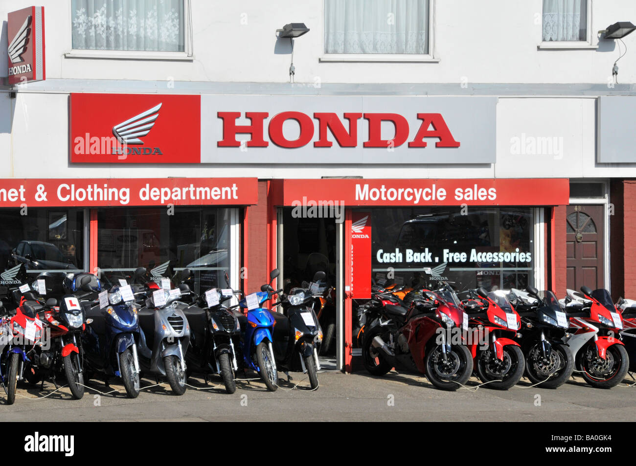 Honda Signs Above Display Of Motorbikes For Sale At A