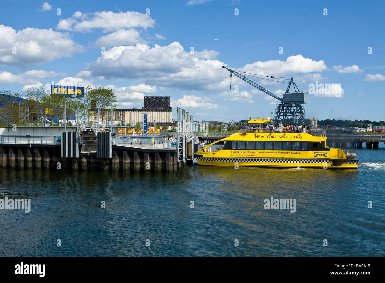 the free new york water taxi pulls into the new ikea in red hook stock photo royalty free image. Black Bedroom Furniture Sets. Home Design Ideas