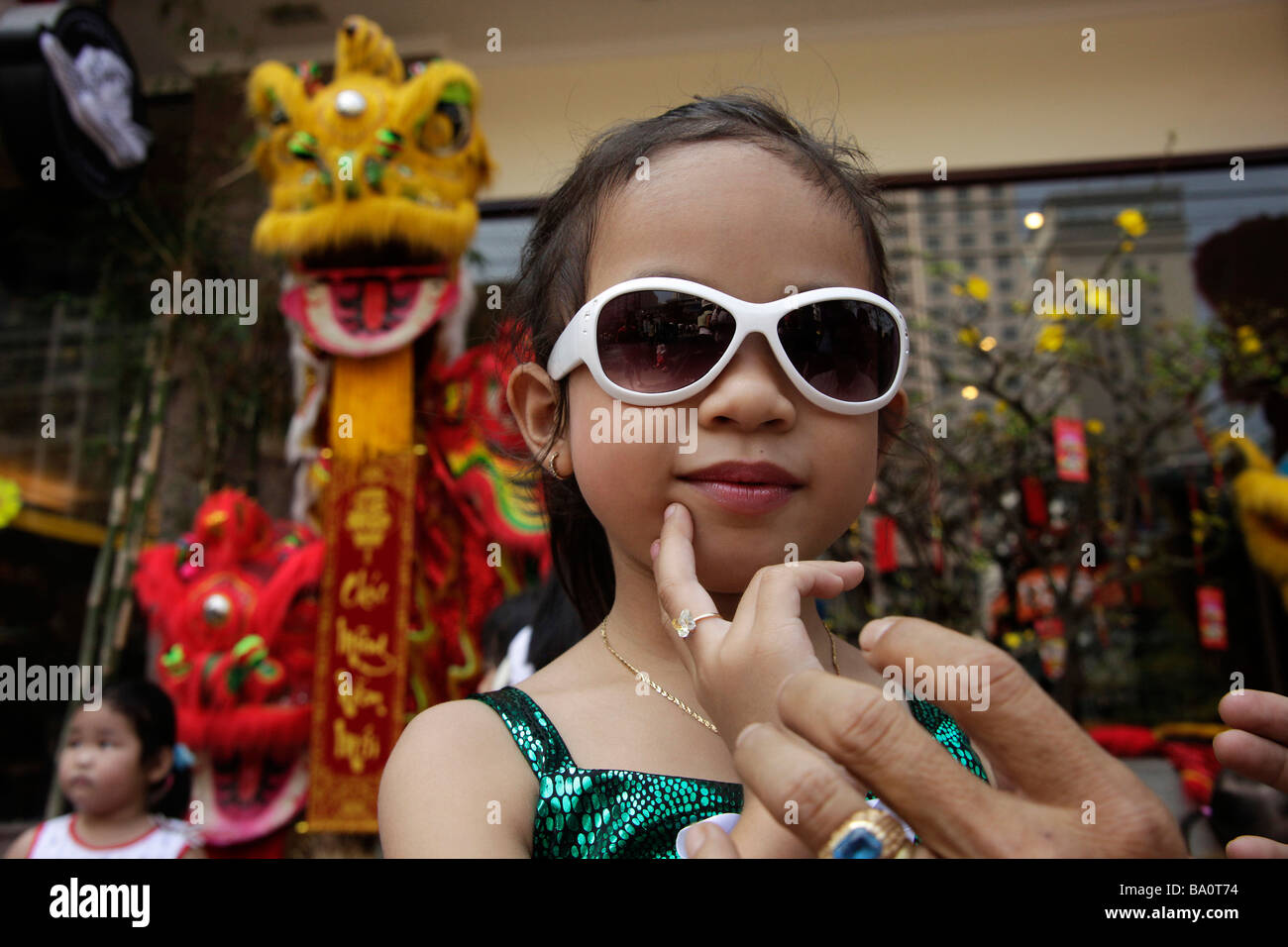 Stock Photo - young girl with sunglasses posing in Saigon Ho Chi <b>Minh City</b> ... - young-girl-with-sunglasses-posing-in-saigon-ho-chi-minh-city-vietnam-BA0T74