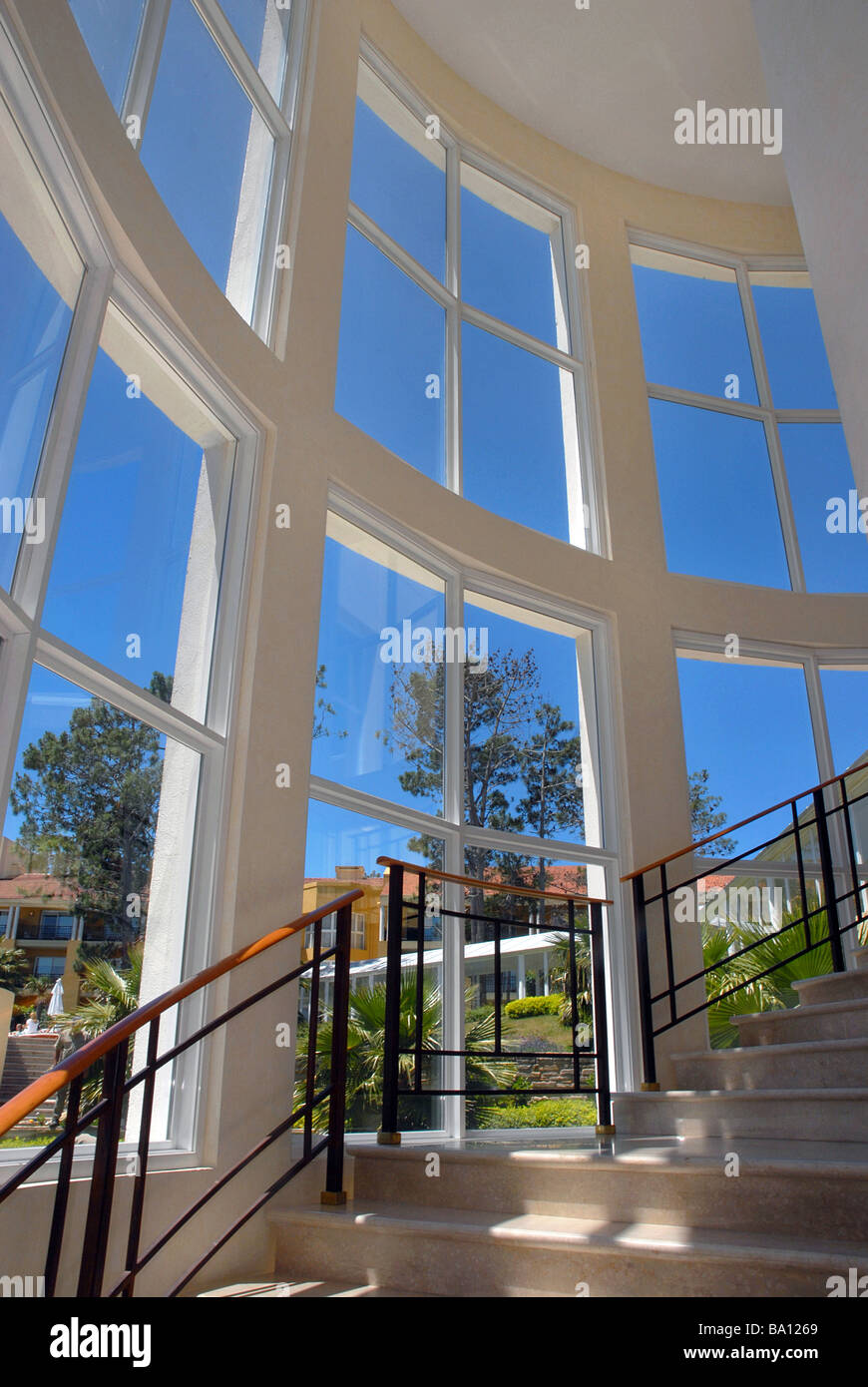 Wide angle picture of stairs and big glass windows interior building