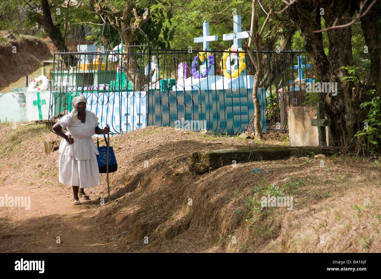 Garifuna Woman Dressed In White Visits The Cemetery In Livingston, Guatemala