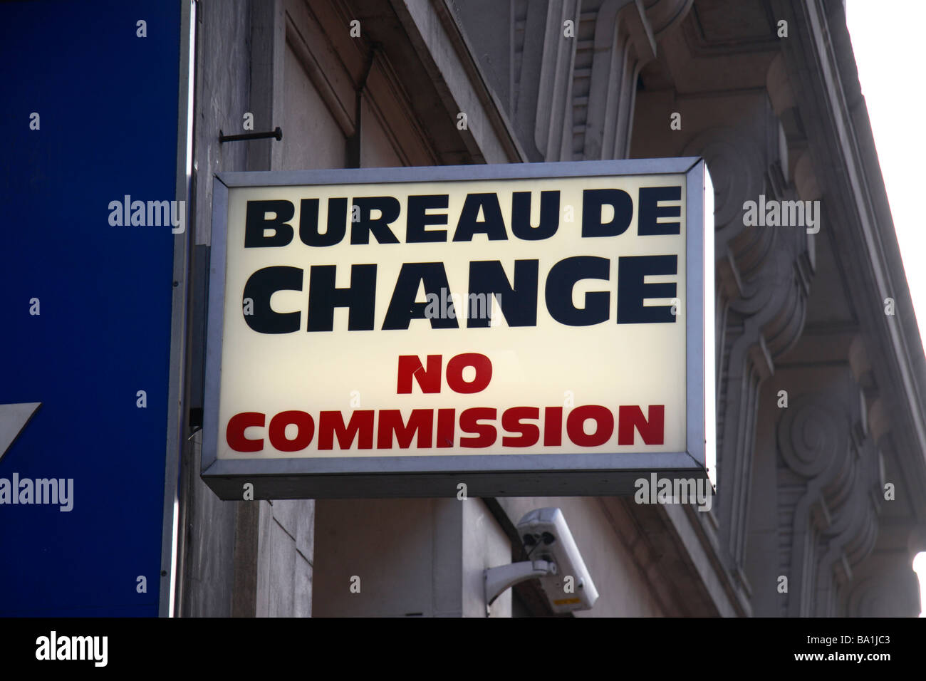 A generic Bureau de Change No Commission sign above a shop on