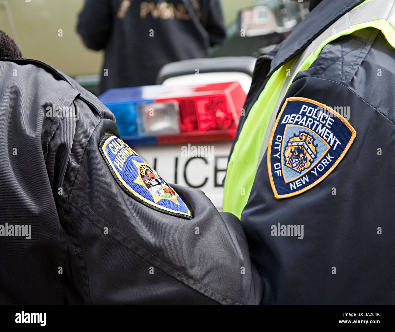 two men wearing police badges on arm for california highway and