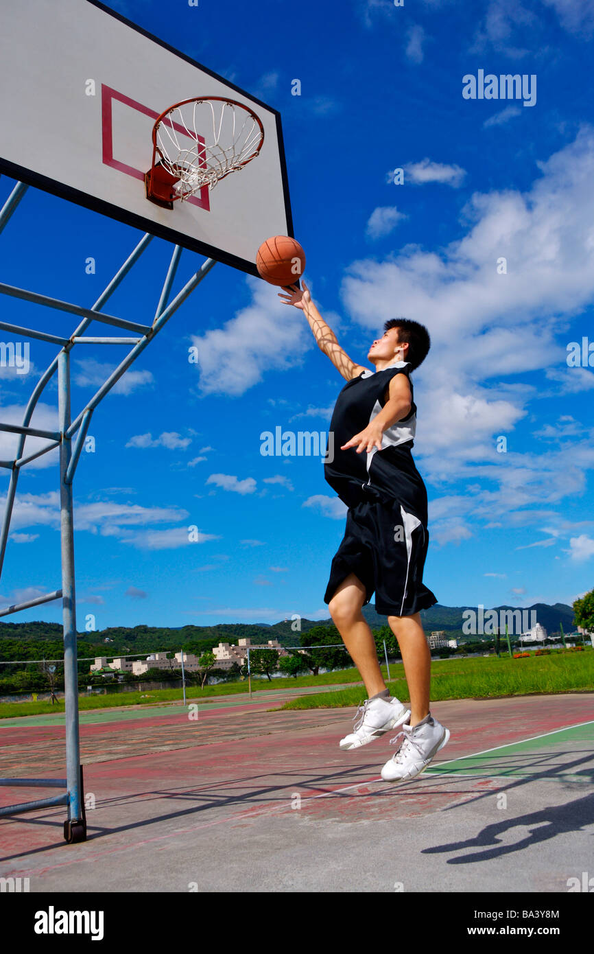 Teenage boy playing basketball Stock Photo: 23444196 - Alamy