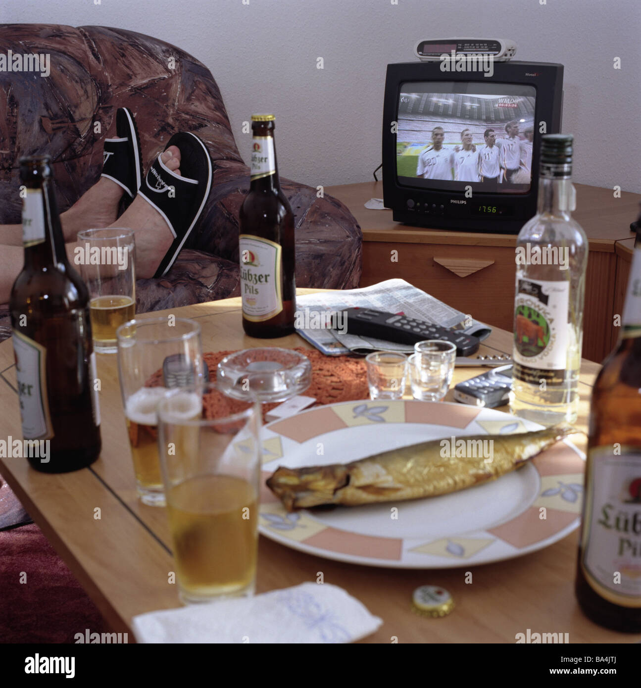 Living rooms man sofa lies detail feet tvs football transfer living rooms man sofa lies detail feet tvs football transfer coffee table plates fish beverage alcohol television evening geotapseo Gallery