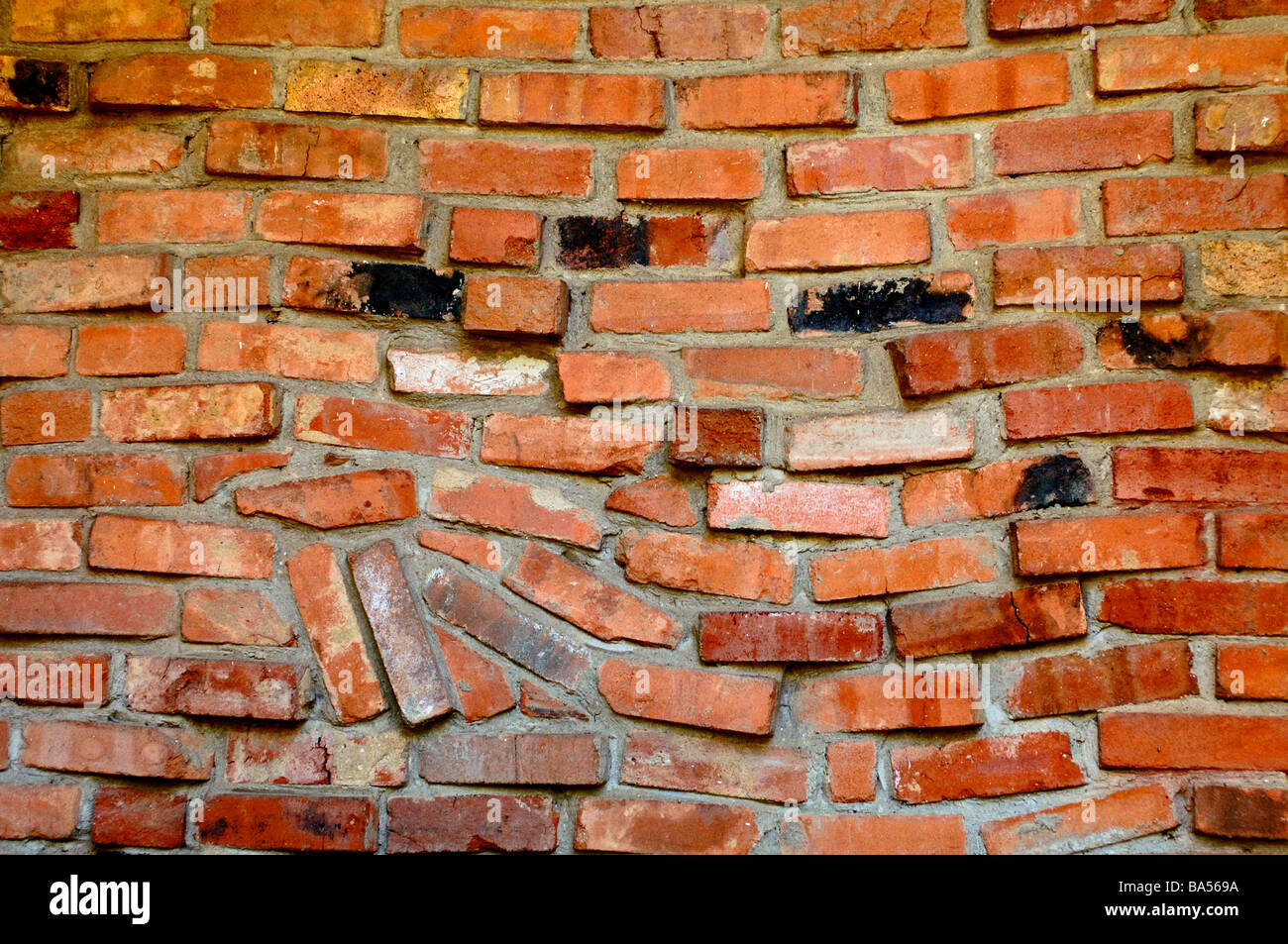 Red Clay Bricks : Red clay bricks laid in a eccentric chaotic design for