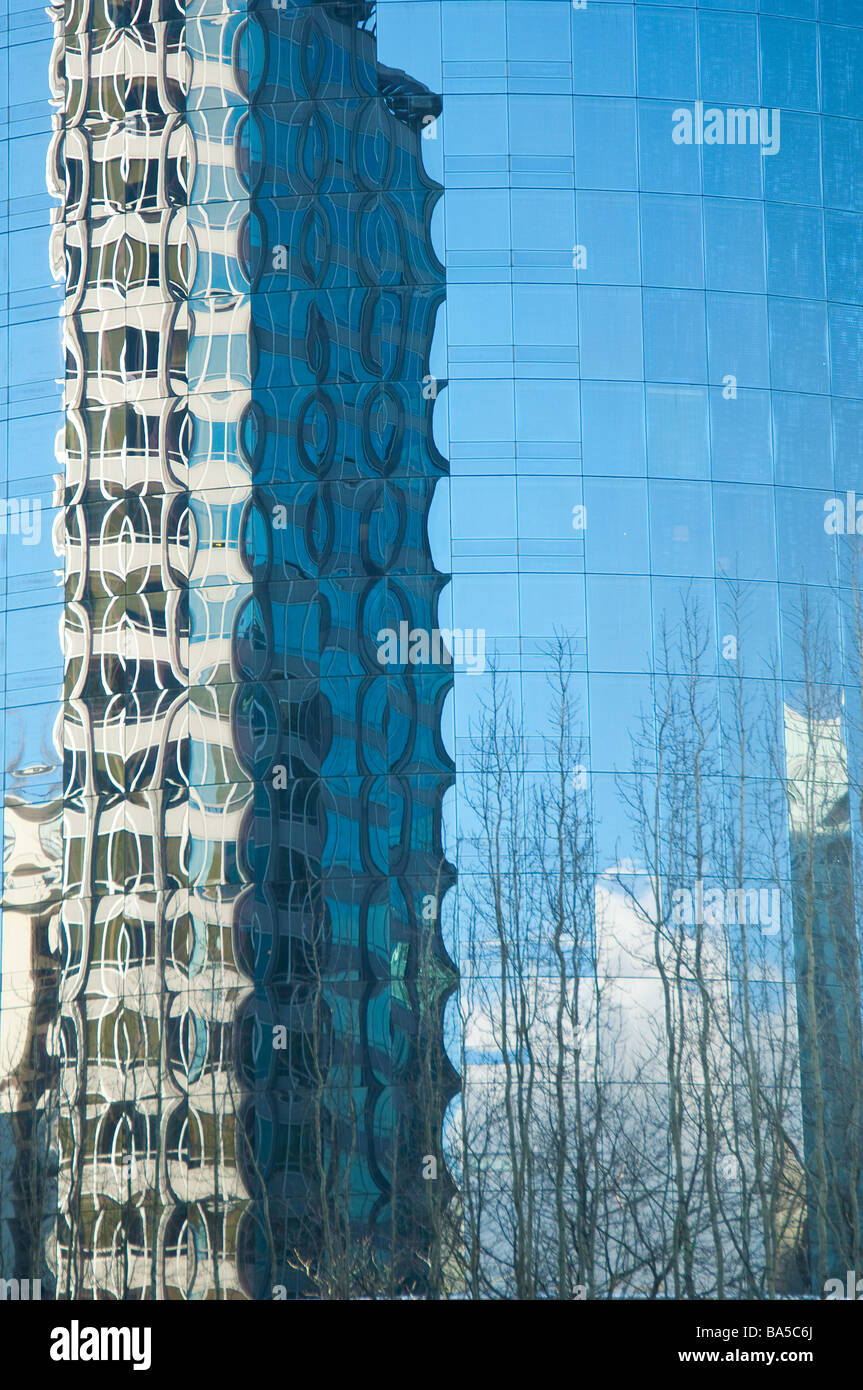Patterns of distortion reflected from the glass facade of a high