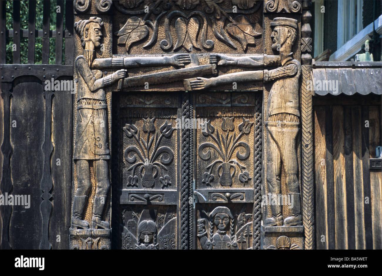 Folk art images on a sculptured or carved wooden door