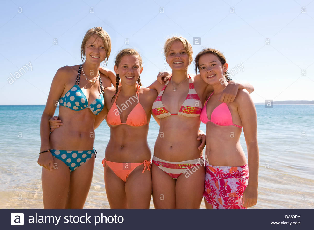 Teenage Girls Posing At Beach