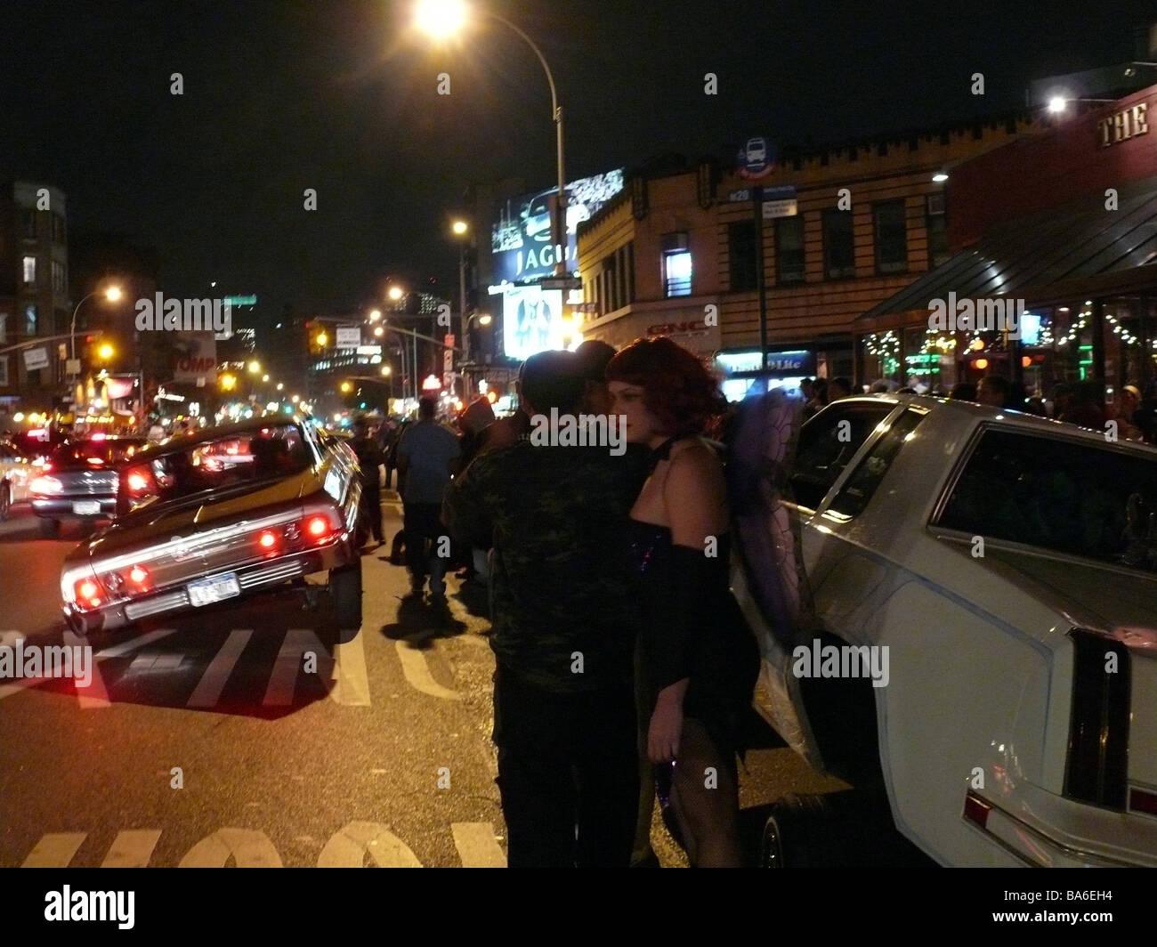 USA New York city Halloween street-scene cars people evening ...