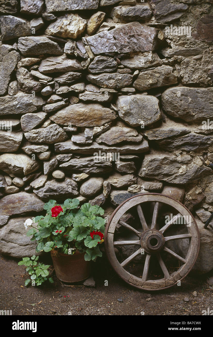 Stone wall detail decoration car wheel flowerpot wall stone stock stone wall detail decoration car wheel flowerpot wall stone nature stone buildings facade stones old flowers wheel wood wheel amipublicfo Images