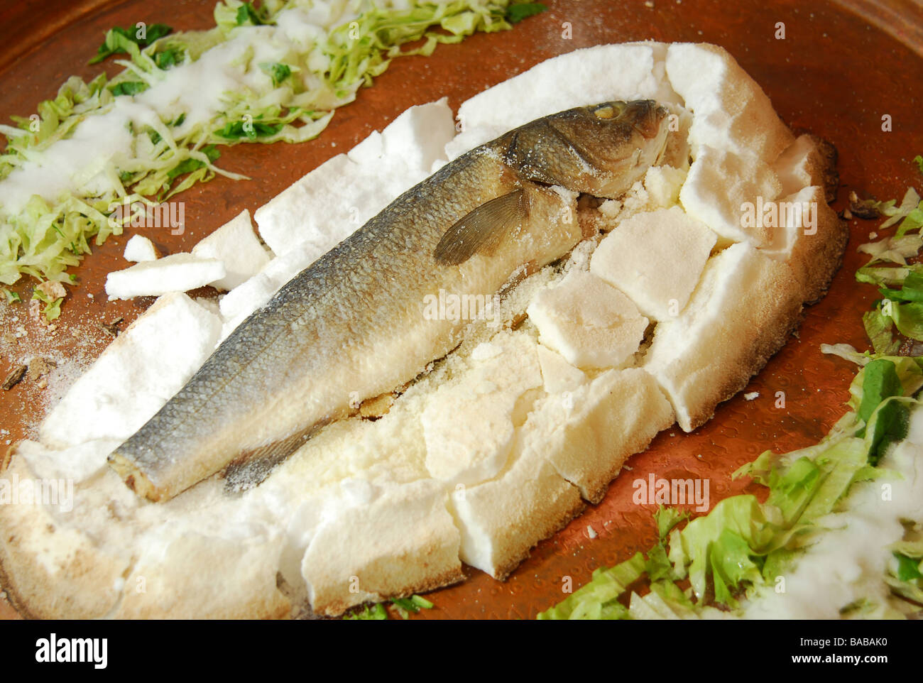 Sea bass cooking with salt traditional mediterranean for Authentic mediterranean cuisine