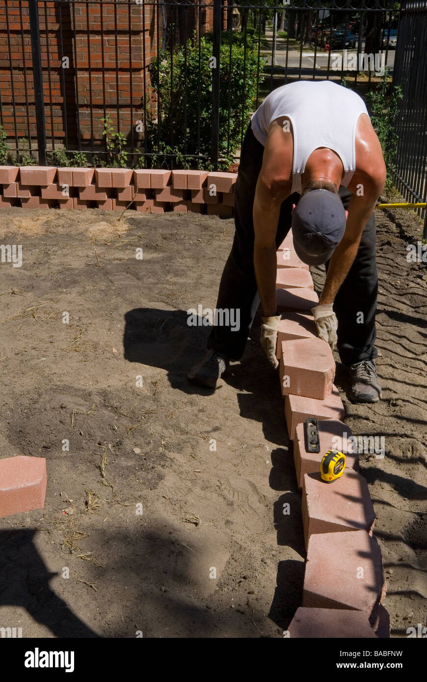 Italian man building flower box retaining wall with pavers for italian man building flower box retaining wall with pavers for flower bed chicago illinois amipublicfo Image collections