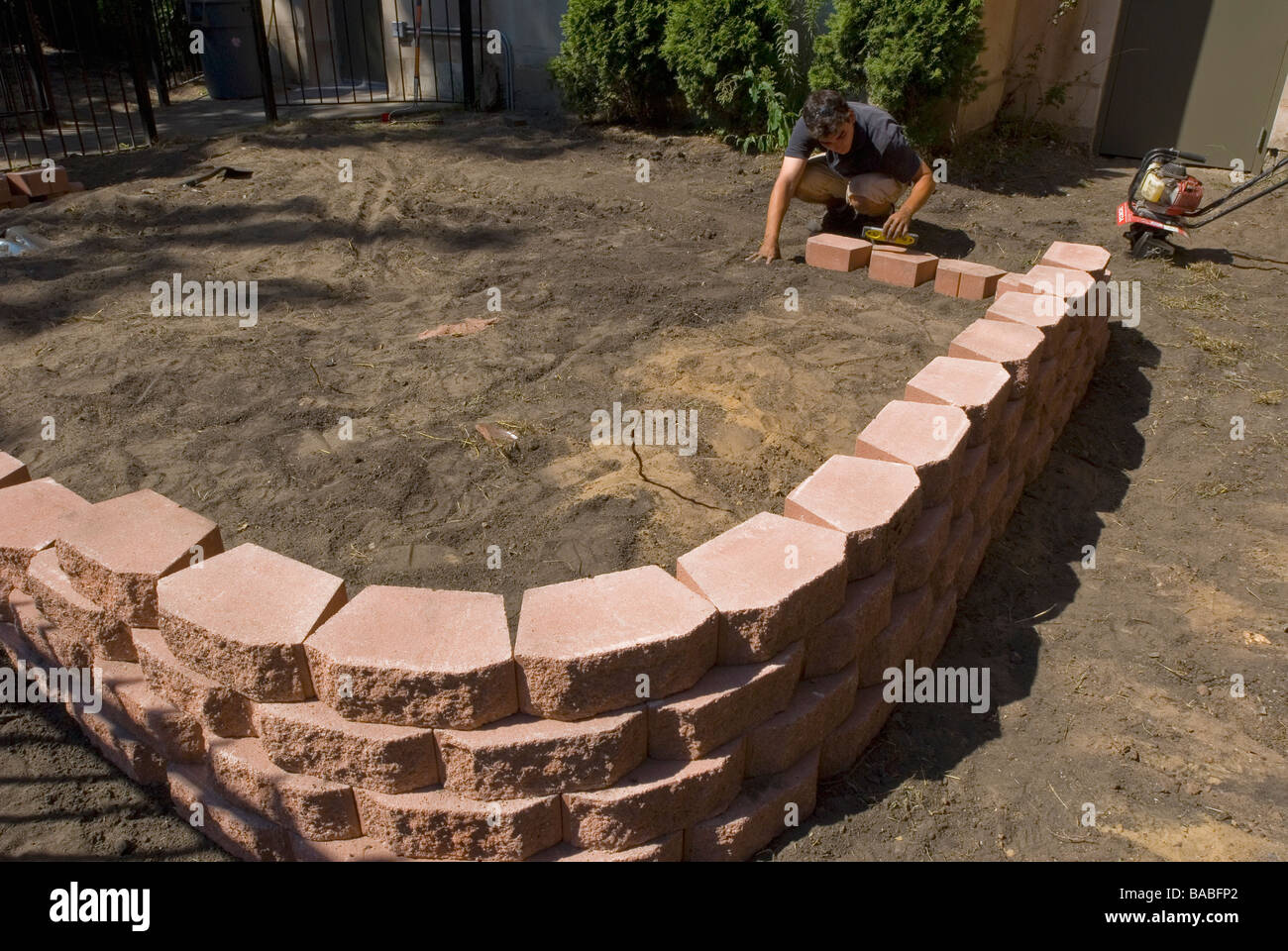 Man building flower box retaining wall with pavers for flower bed man building flower box retaining wall with pavers for flower bed chicago illinois amipublicfo Image collections
