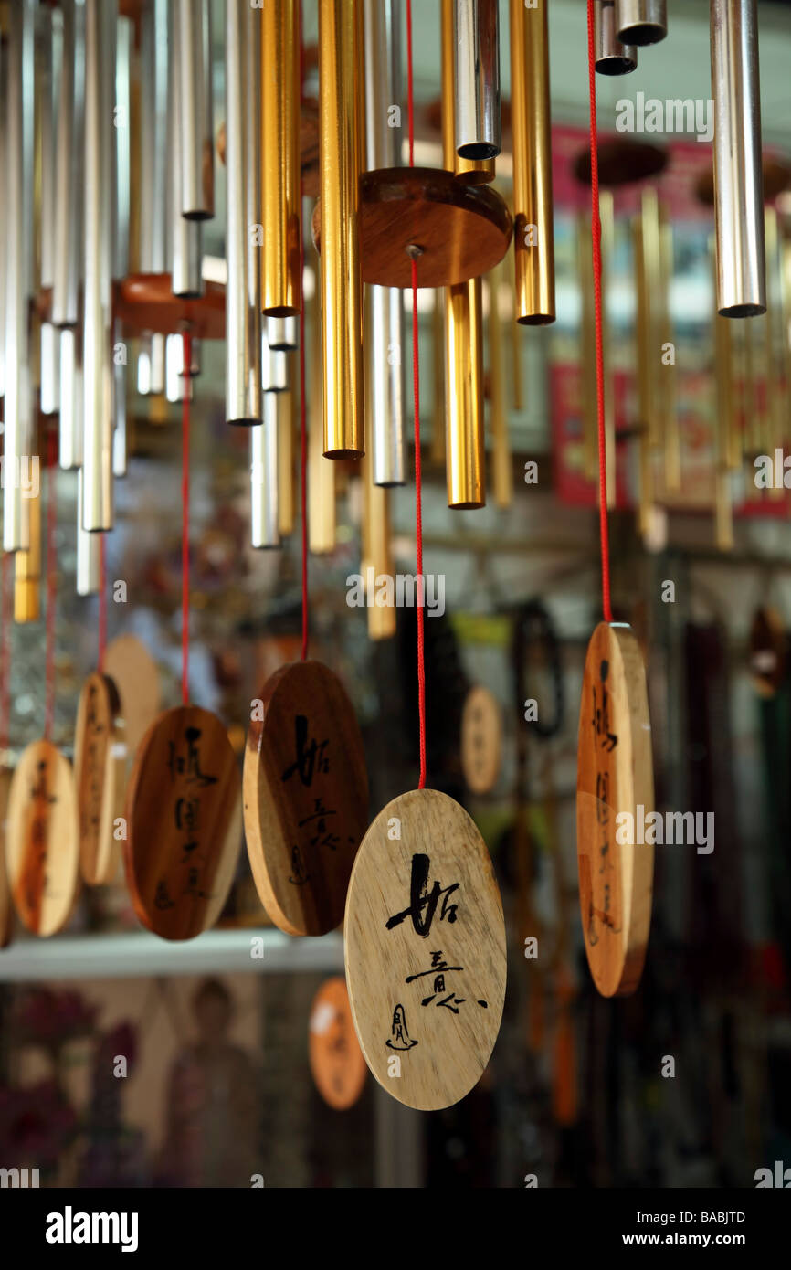 Wind chimes with chinese symbols at a buddhist monastery stock photo wind chimes with chinese symbols at a buddhist monastery buycottarizona Choice Image