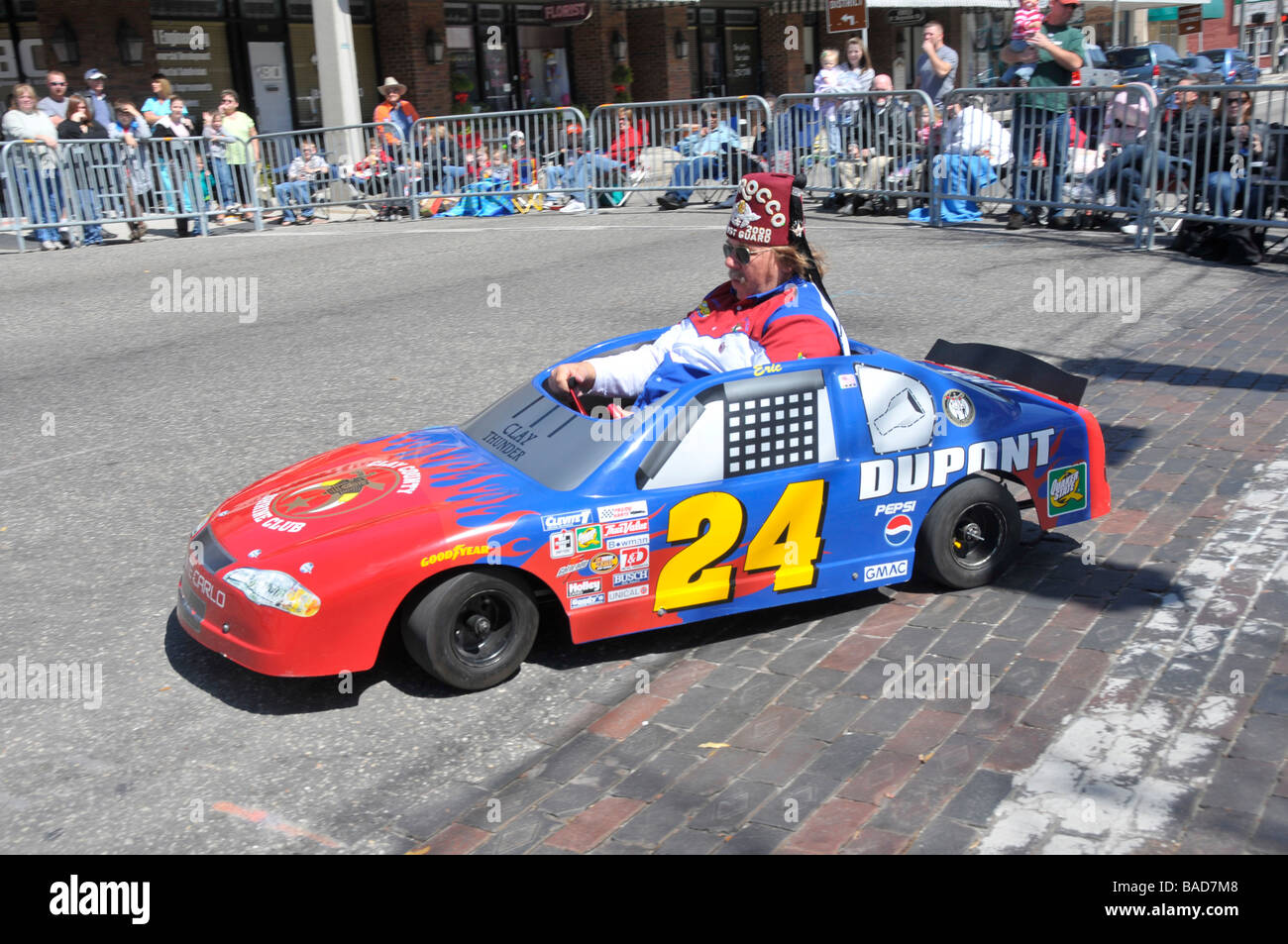 Shriners in miniature cars in strawberry festival parade plant city florida stock image