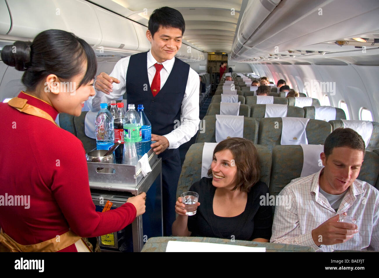 flight attendants stock photos flight attendants stock images flight attendants serve beverages to passengers on a viet se airliner stock image
