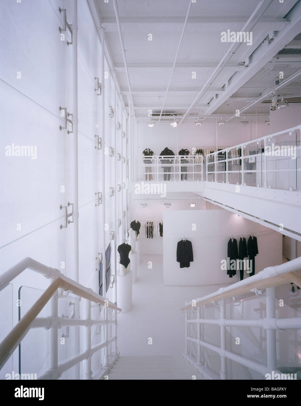 Stock Photo   Dkny Shop Overall Interior View Top Staircase Showing 1st Floor  Gallery Mannequins Merchandise On Ground Floor Dkny New Bond St