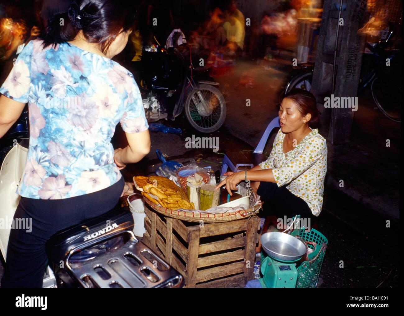Stock Photo - street food vendor, night market, Hanoi, Vietnam