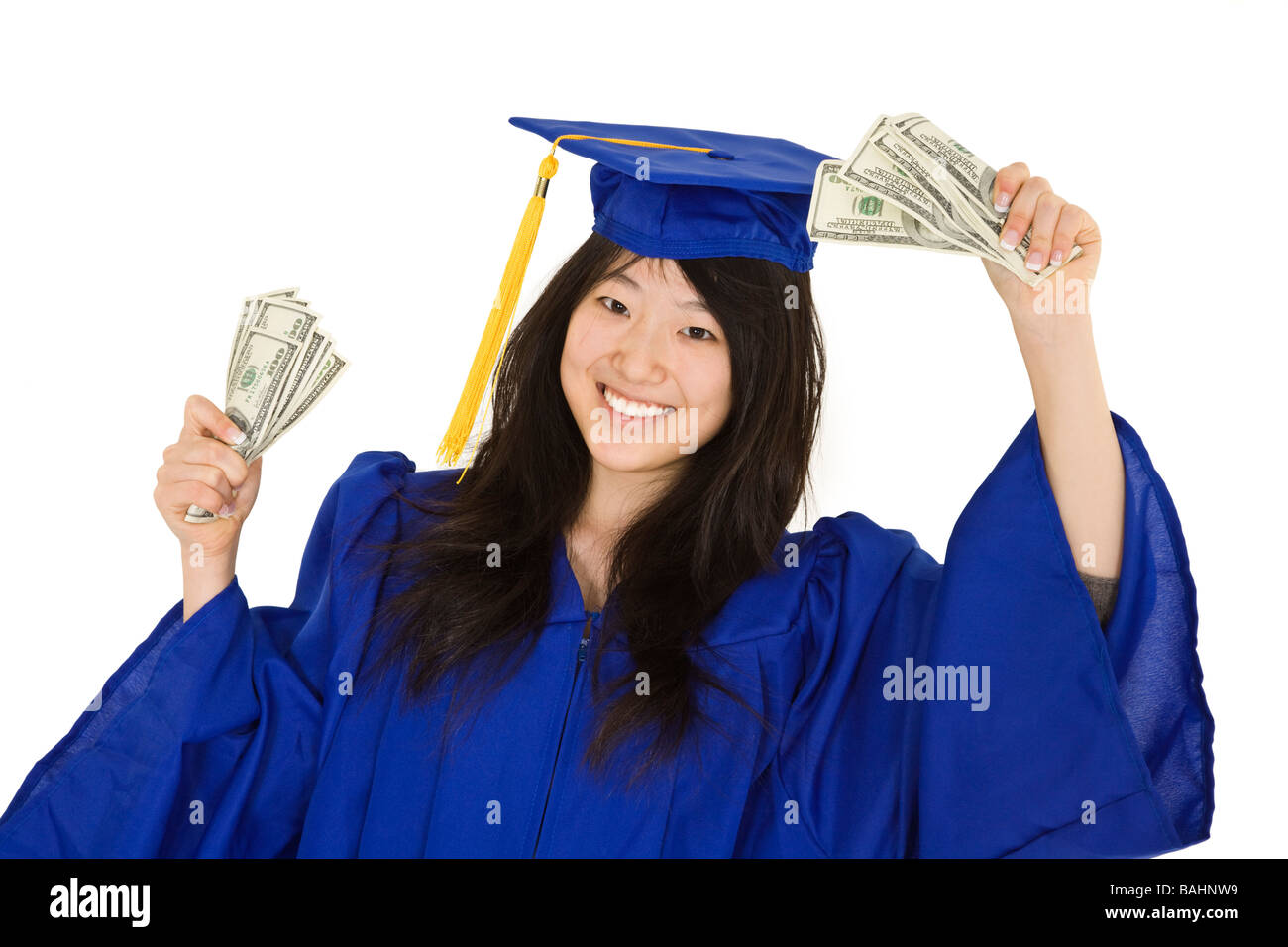 An Asian Teenager In A Graduation Gown Smiling While Holding Money ...