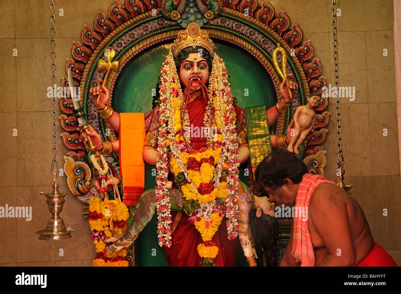 Hindu priest during a ceremony inside the Sri Veeramakali ...