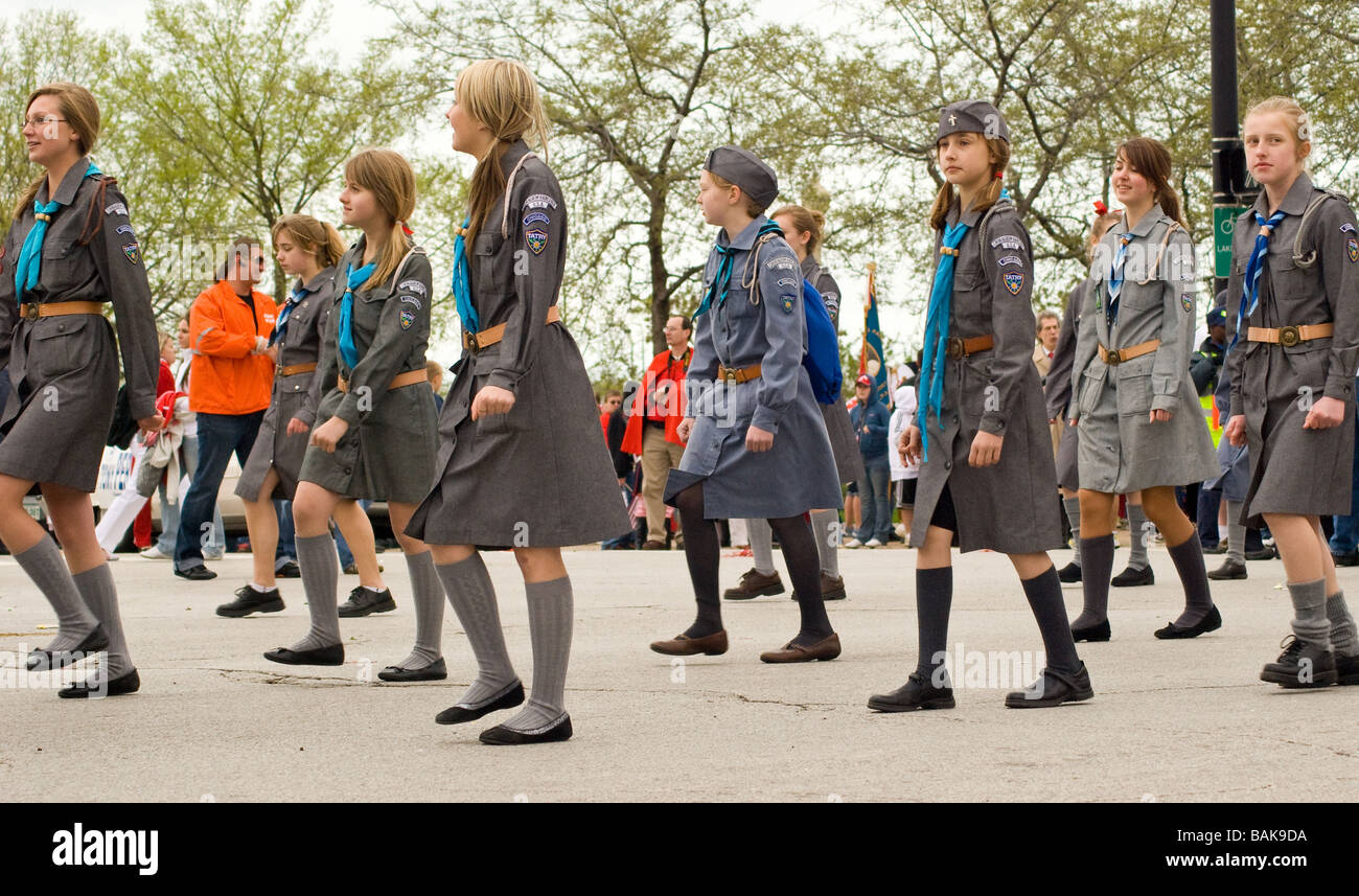 rows of girls in scout uniforms march in the chicago