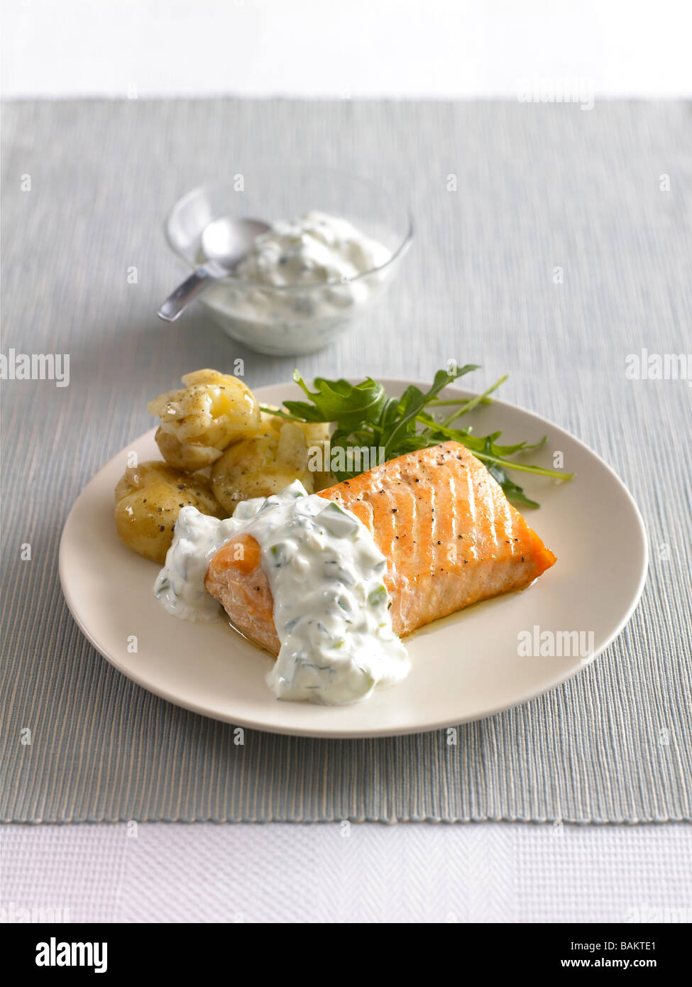 Baked Salmon with Cucumber and dill sauce and new potatoes ...