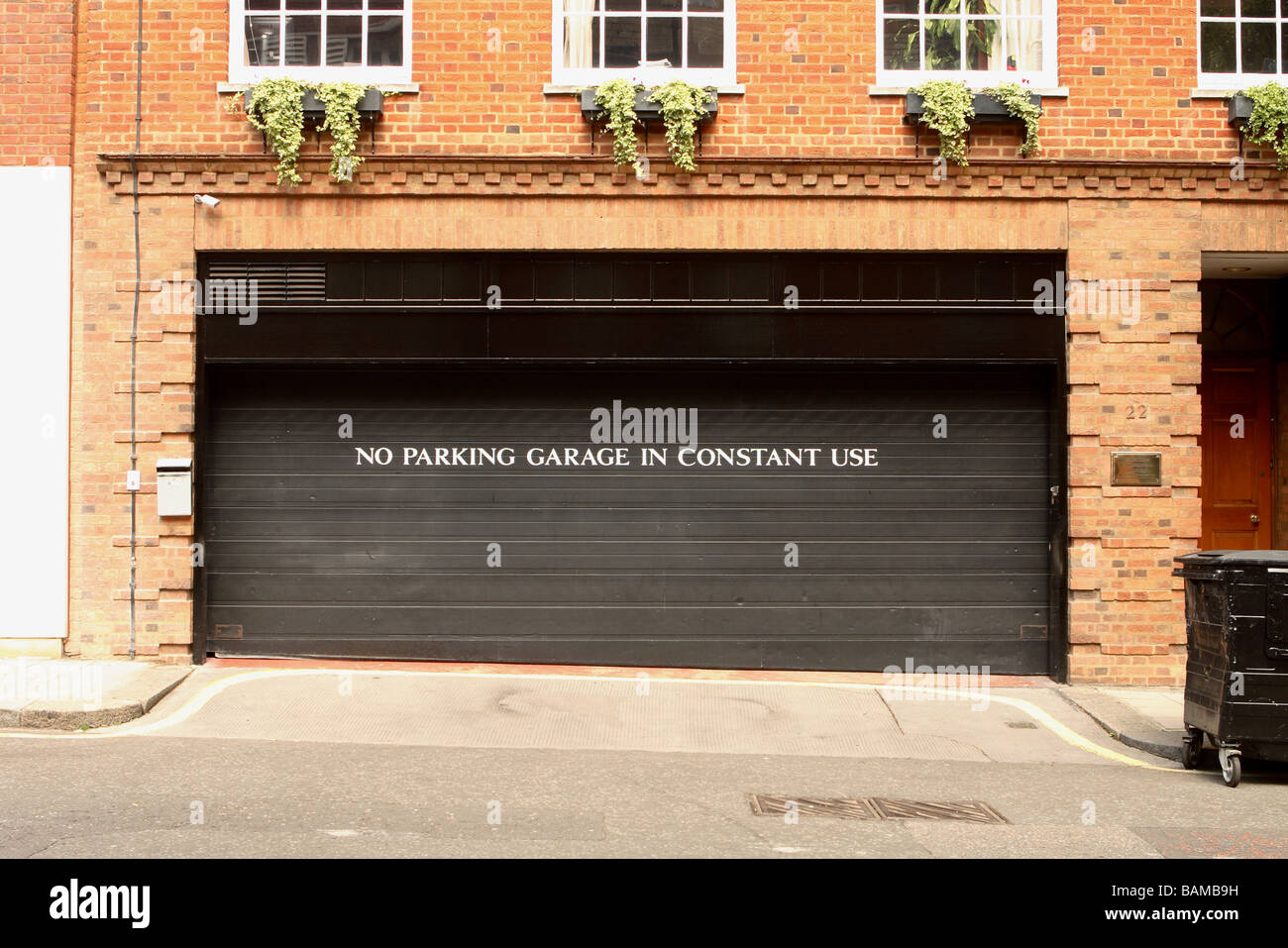 London no parking garage in constant use warning sign on