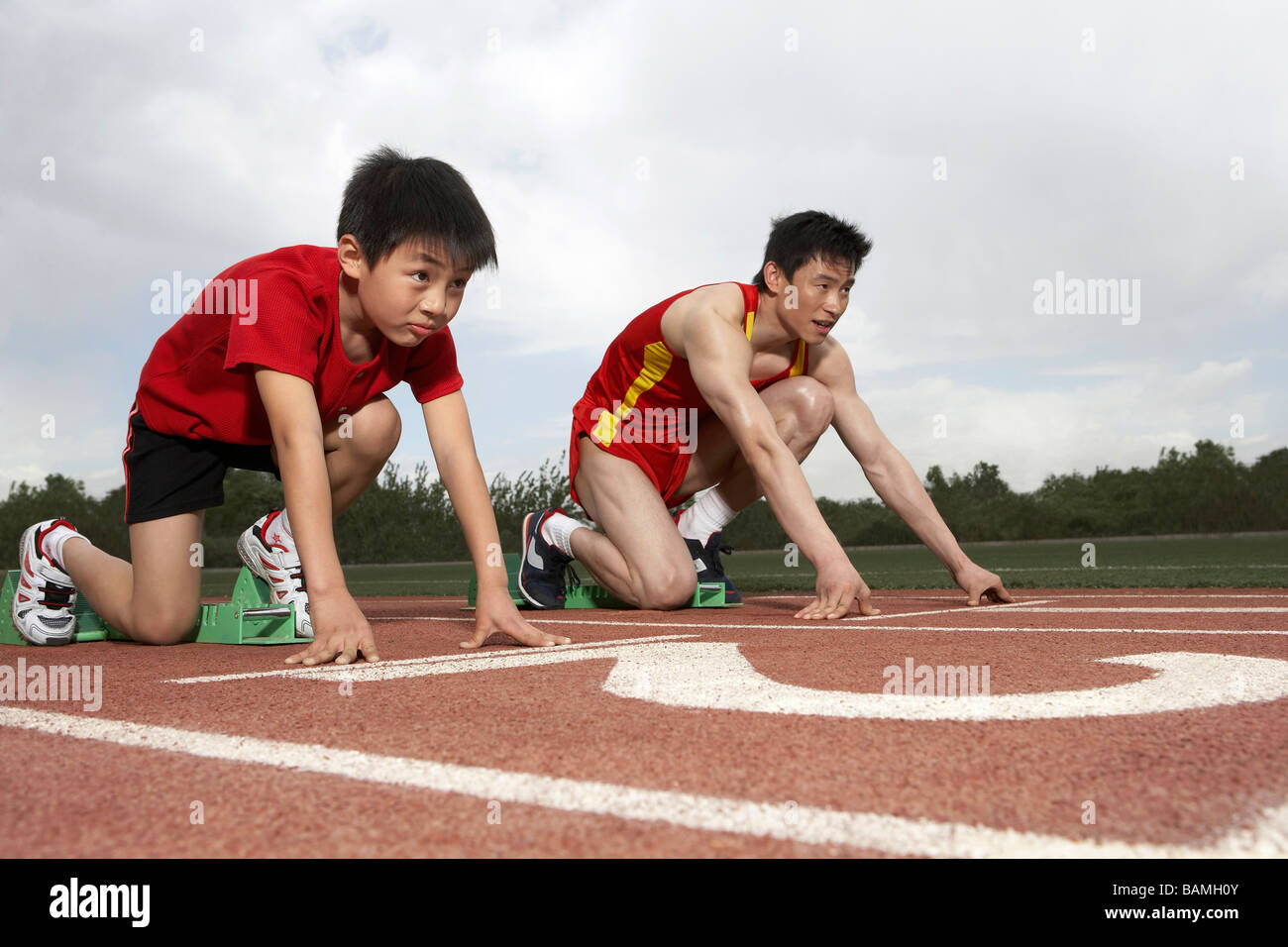 Young Man And Child Getting Ready To Start A Running Race ...