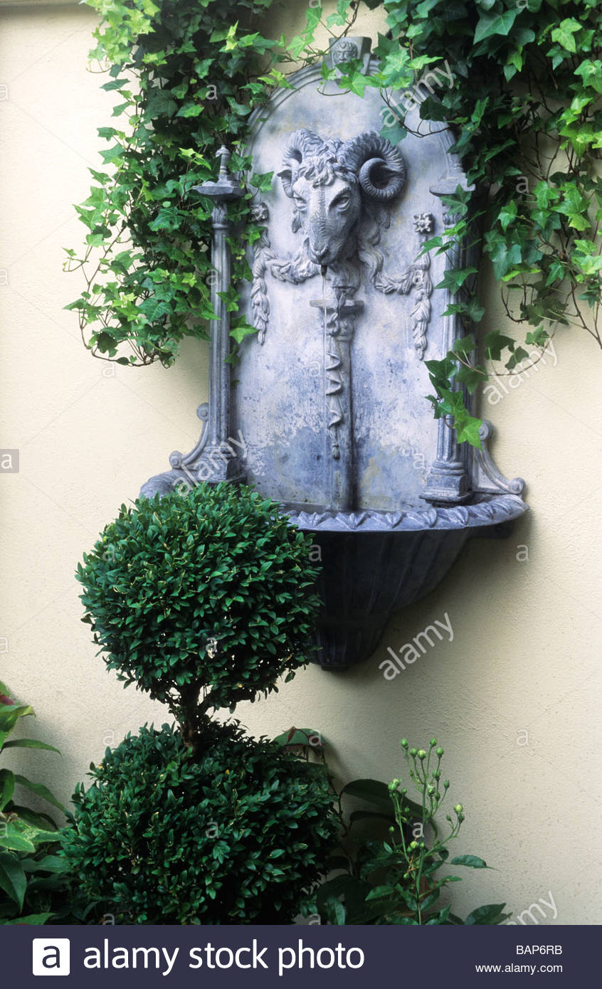 Modern Wall Mounted Ram Head Water Feature Faux Lead Boxwood Topiary Busy  Lizzies And Ivy In Trough