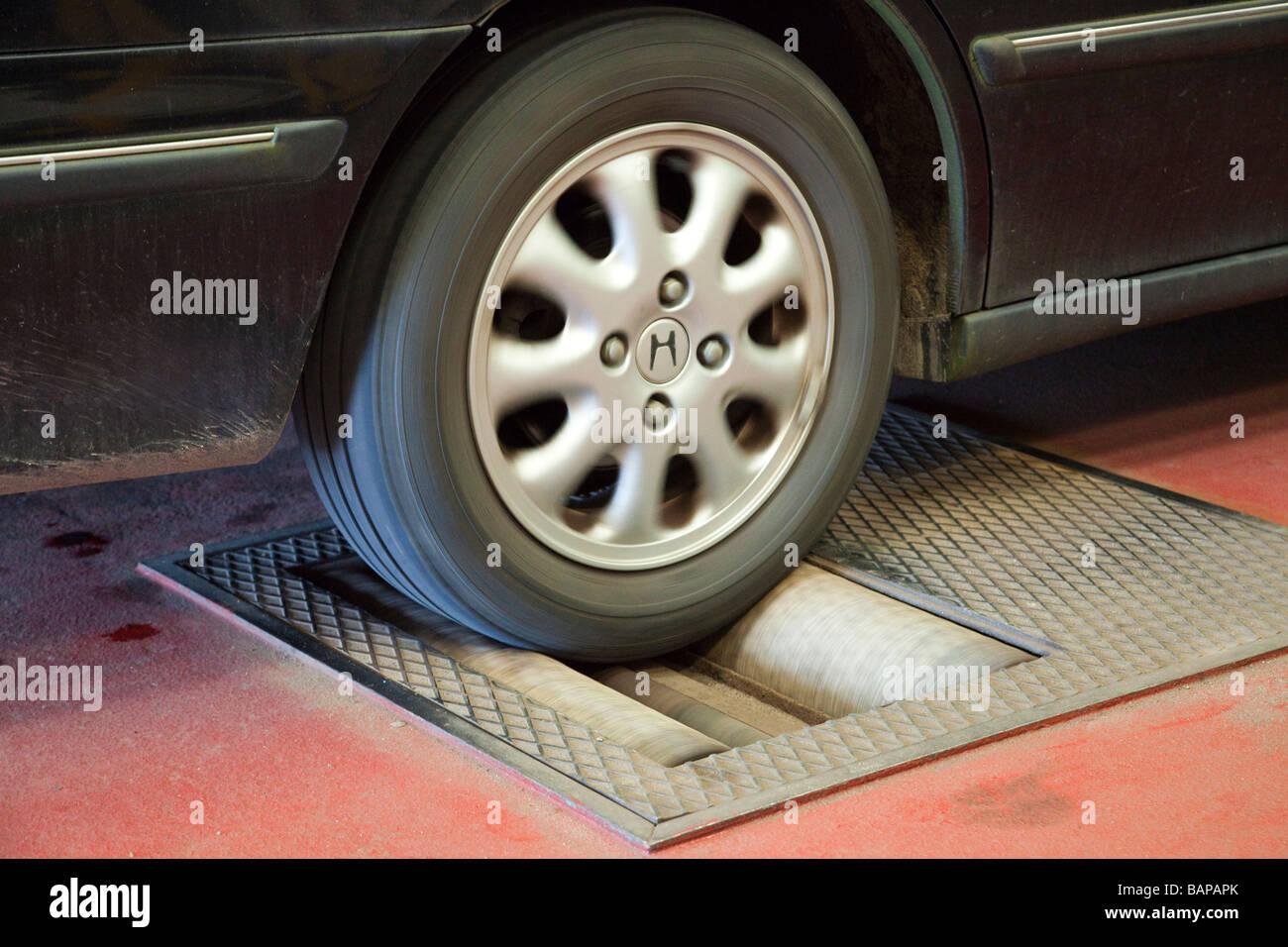 Car Brake Test : Car on a rolling road dynamometer to check brake