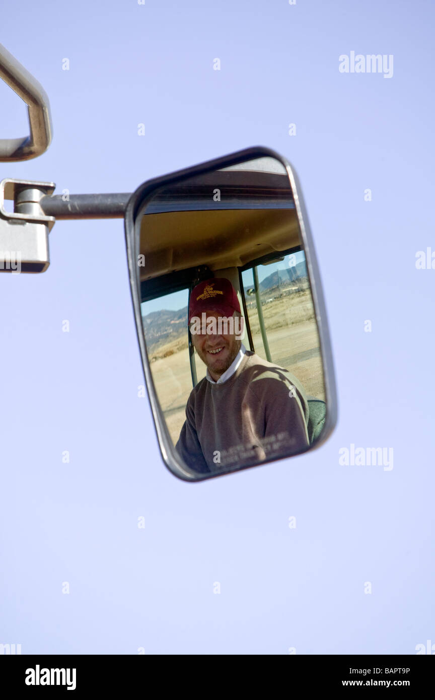 view in the mirror of the operator of a front end loader which is