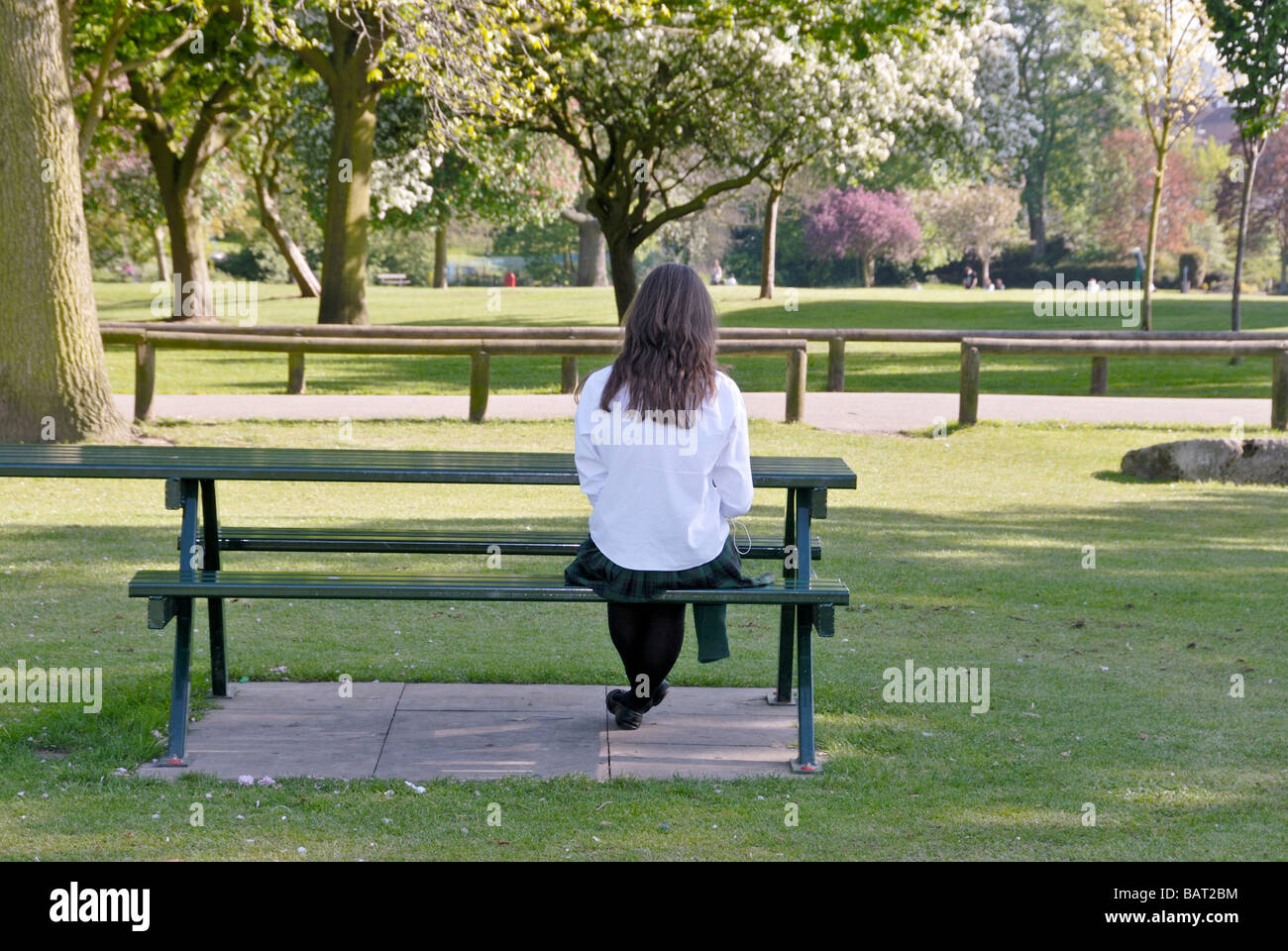 A Girl Sitting On A Bench Lonely The Image Kid Has It